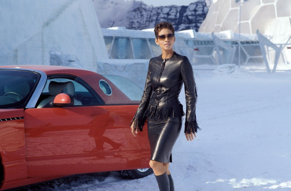 In Die Another Day (2002), Halle Berry bucks the fur trend with this black leather combo, complete with cowgirl tassle trim. She may have cold knees though