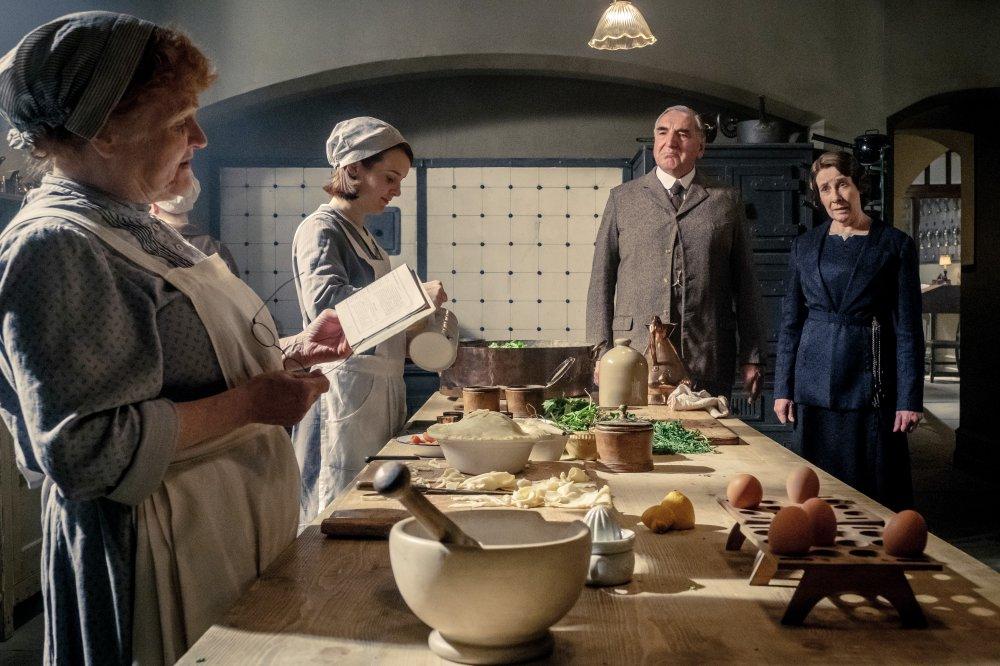 Lesley Nicol as Mrs. Patmore, Sophie McShera as Daisy Mason, Jim Carter as Charles Carson and Phyllis Logan as Mrs. Hughes