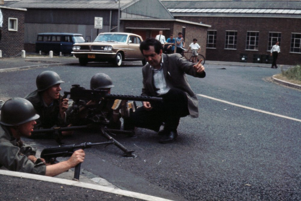 Stanley Kubrick directs gunmen during the scene in which US forces lay siege to their own airforce base.