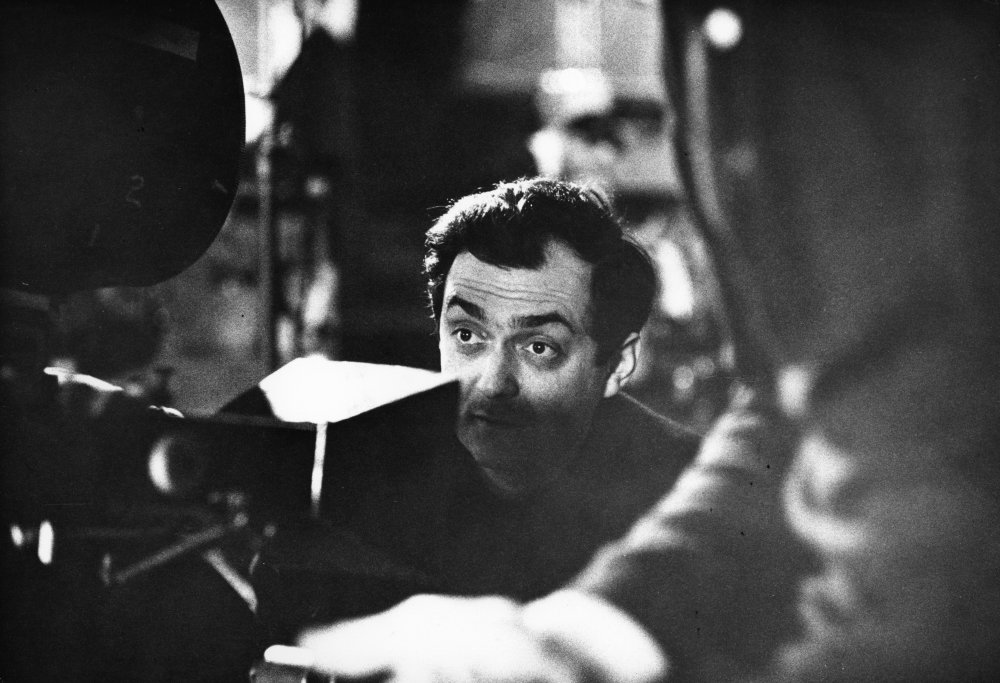 Kubrick watches through the viewfinder.