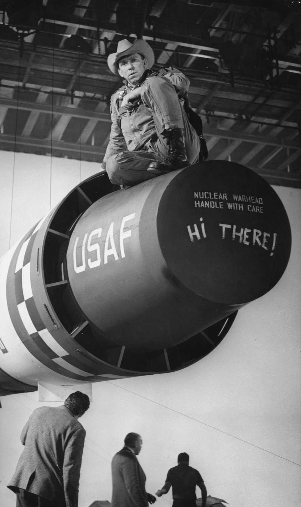 Actor Slim Pickens gets into position on the atomic bomb. Clutching his cowboy hat, Major T. J. 'King' Kong (Pickens) will ride the bomb as it is dropped onto its Soviet target – truly a horseman of the apocalypse.