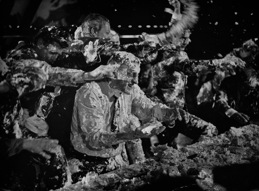 George C. Scott in the middle of the unused custard pie fight scene from Dr. Strangelove (1963).