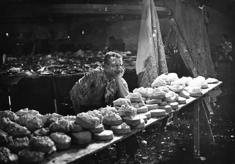 George C. Scott behind the pastry buffet table
