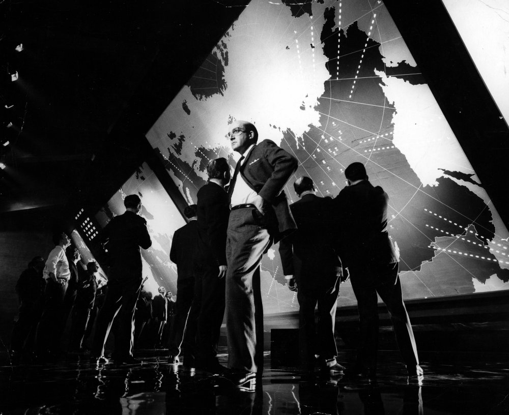 Peter Sellers as President Merkin Muffley with fellow world leaders in Dr. Strangelove