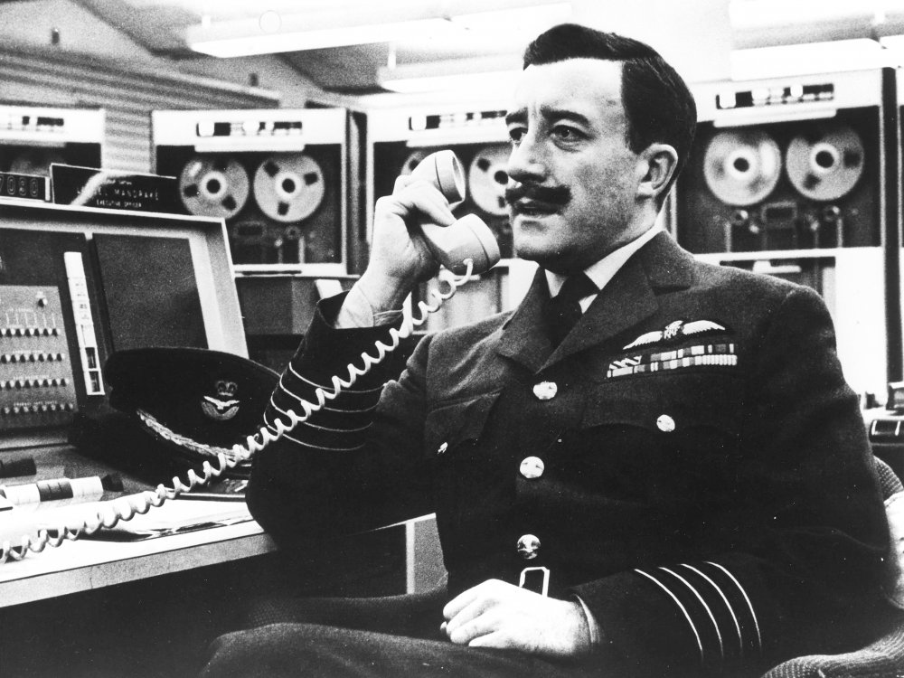 Peter Sellers as Group Captain Lionel Mandrake in Dr Strangelove or: How I Learned to Stop Worrying and Love the Bomb