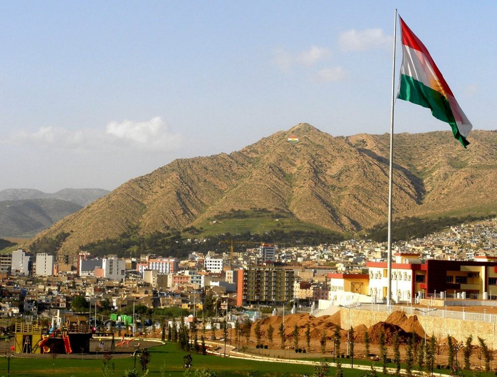 The Kurdish flag flies over Duhok, capital of the northernmost governorate of the Kurdistan Region of Iraq