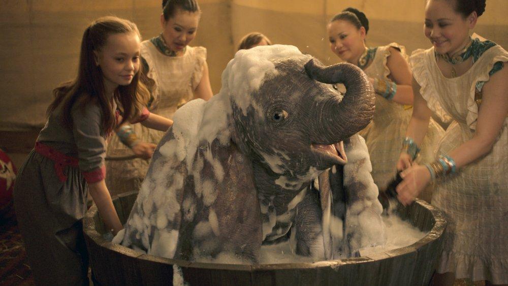 Nico Parker as Milly Farrier (left) in Dumbo