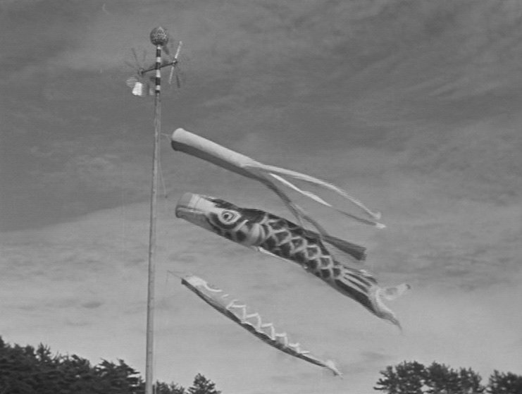 The repercussions of the Second World War: the family's missing son Shoji is a constant absence, and these fluttering flags follow a conversation clearly suggesting he won't ever come back