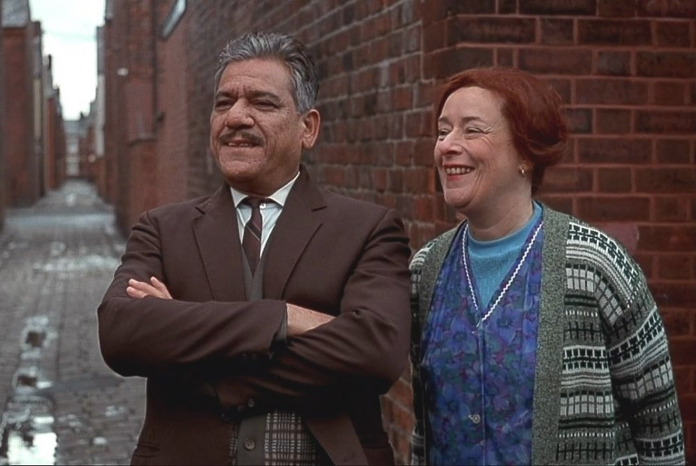 As George Khan with Linda Bassett in East Is East (1999)