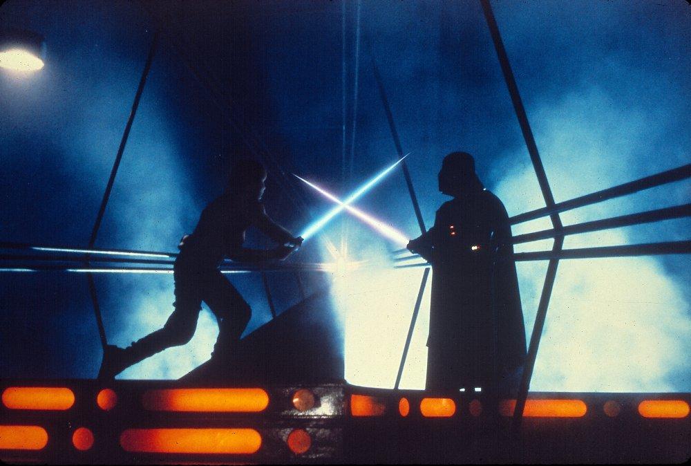 Luke Skywalker and Darth Vader cross sabres in The Empire Strikes Back