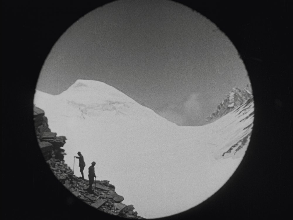 George Mallory and Sandy Irvine ascending Everest, seen through a telephoto lens