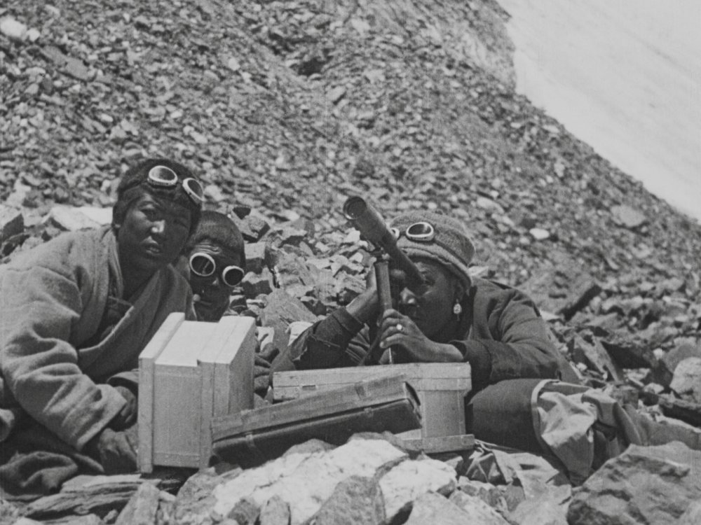 Sherpas with a telescope