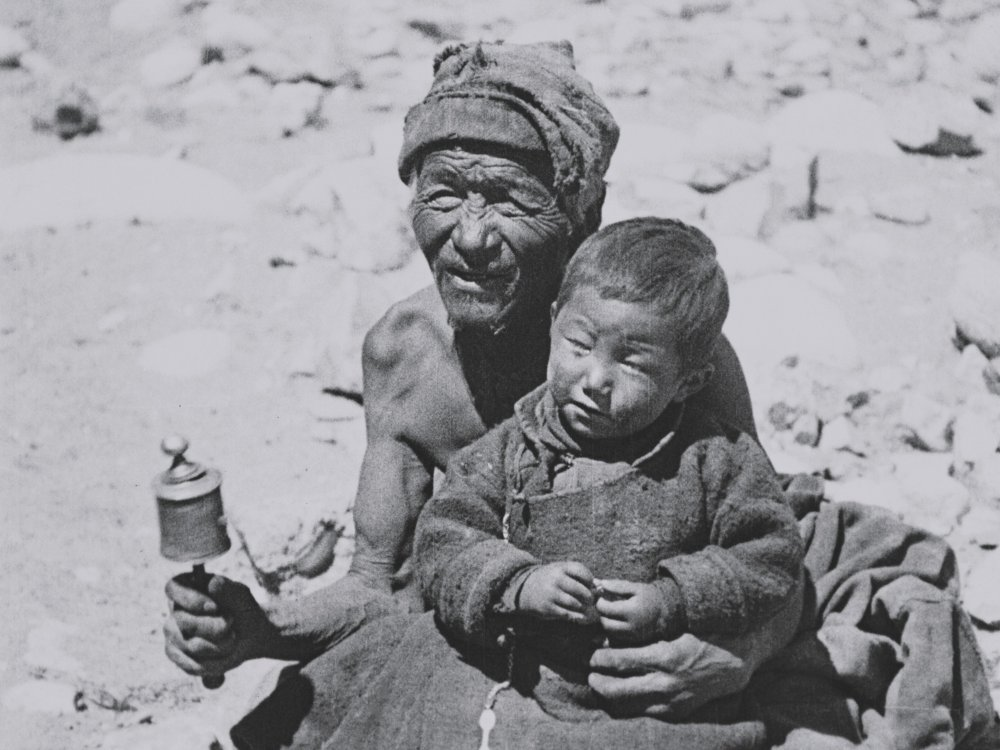Tibetans with a prayer wheel