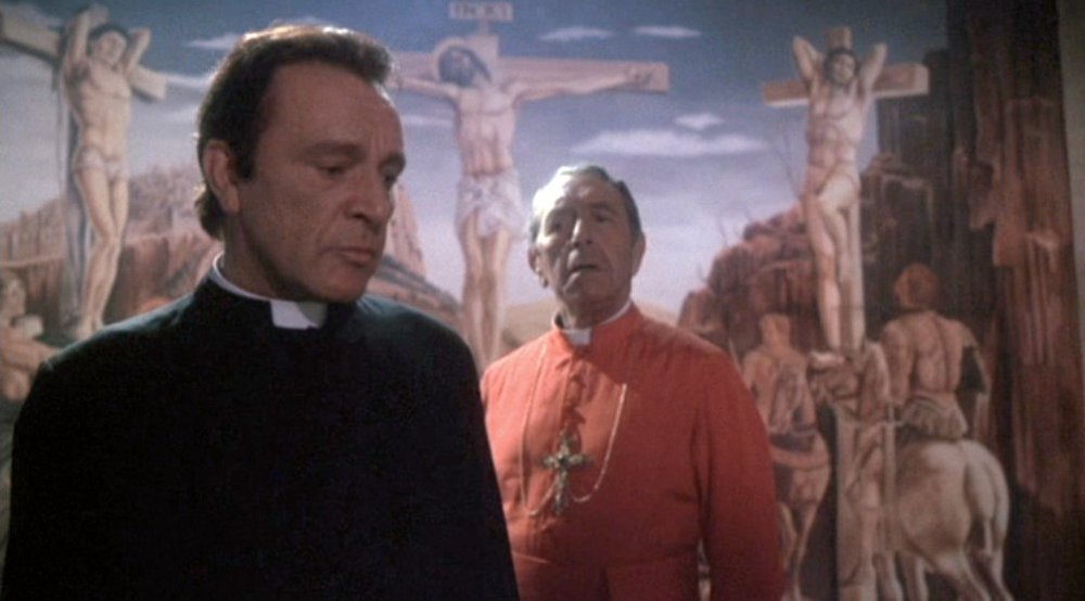 Richard Burton as Father Lamont (left) in Exorcist II: The Heretic