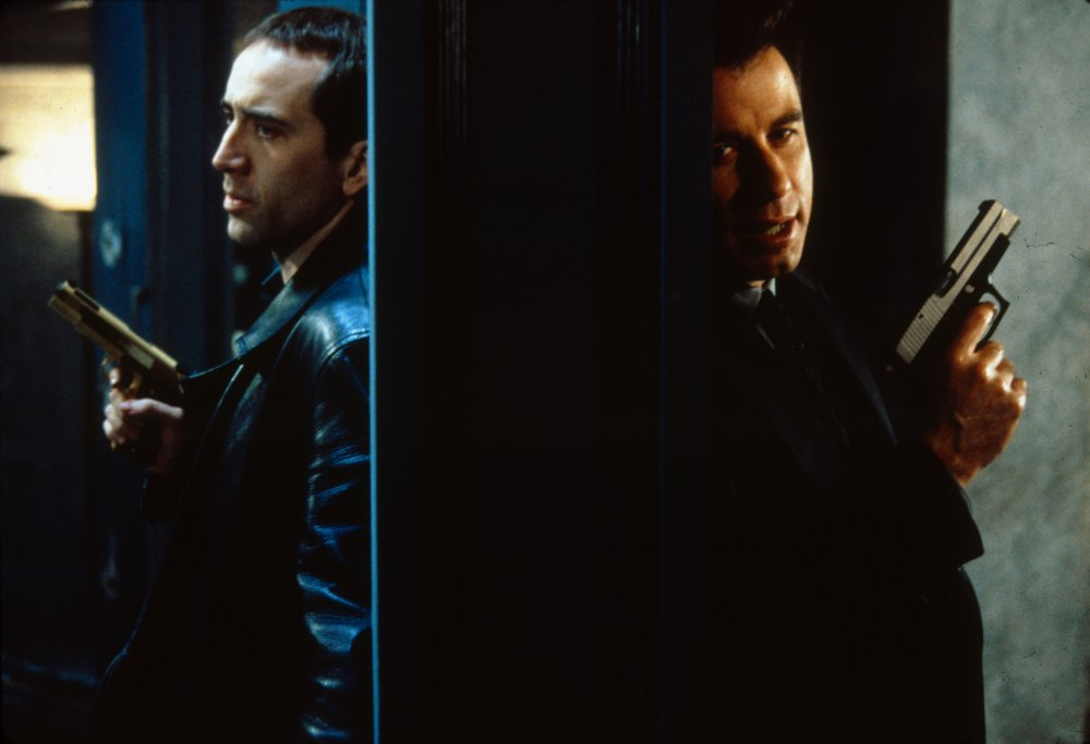 Travolta played opposite Nicholas Cage on different sides of the law in John Woo's high-octane action thriller Face-Off (1997)