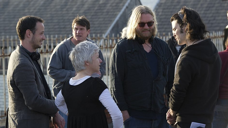 Allan Cubitt (second right) on the set of The Fall.