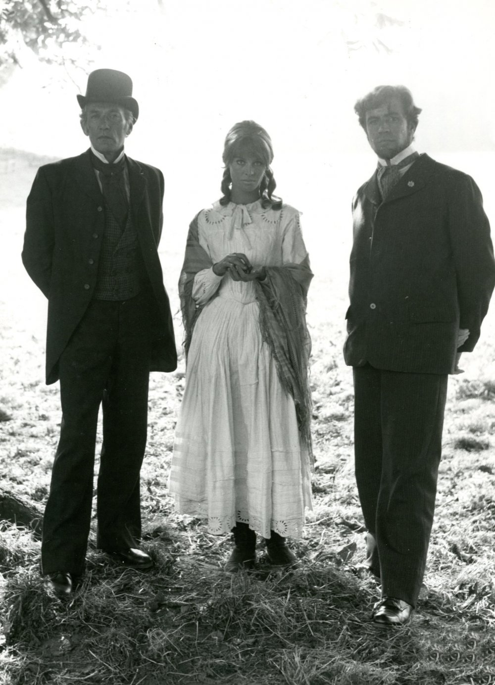 Julie Christie in the white dress, flanked by her two suitors, Peter Finch as Mr Boldwood and Alan Bates as Gabriel Oak