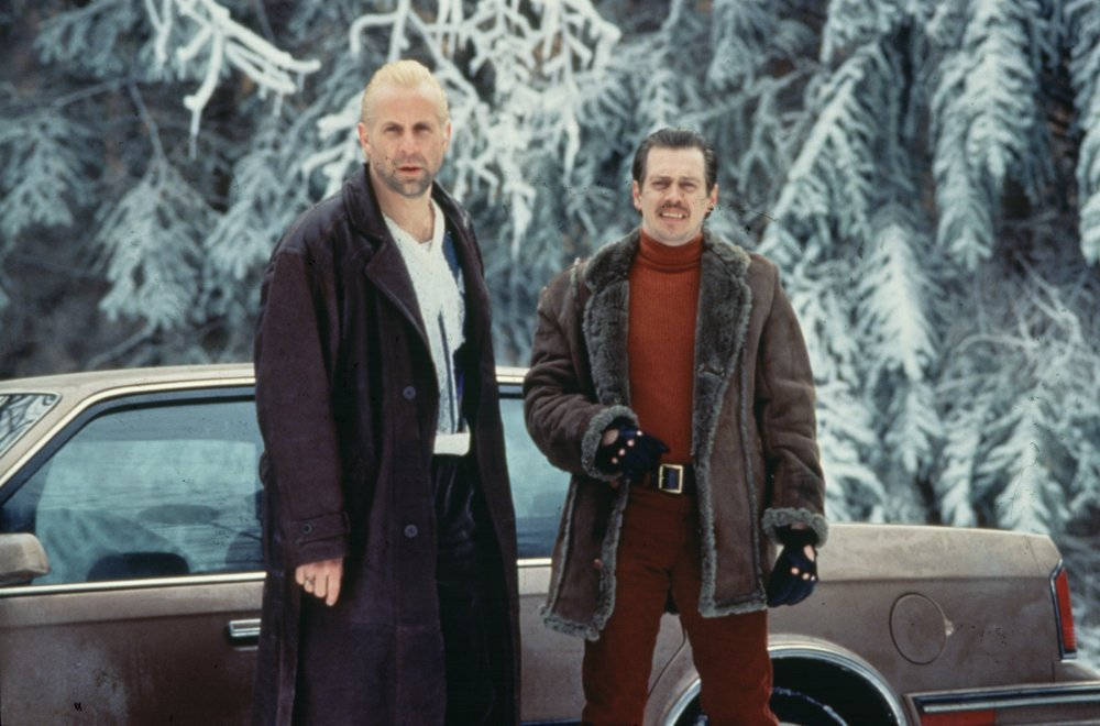 Fargo (1996). No need to bat an eyelid at Gaear Grimsrud's (Peter Stormare) long leather coat; that's standard killer's attire. But look again at what his partner Carl Showalter (Steve Buscemi) is modelling: red trousers with a red polo neck sweater – these are bold choices for winter in Minnesota