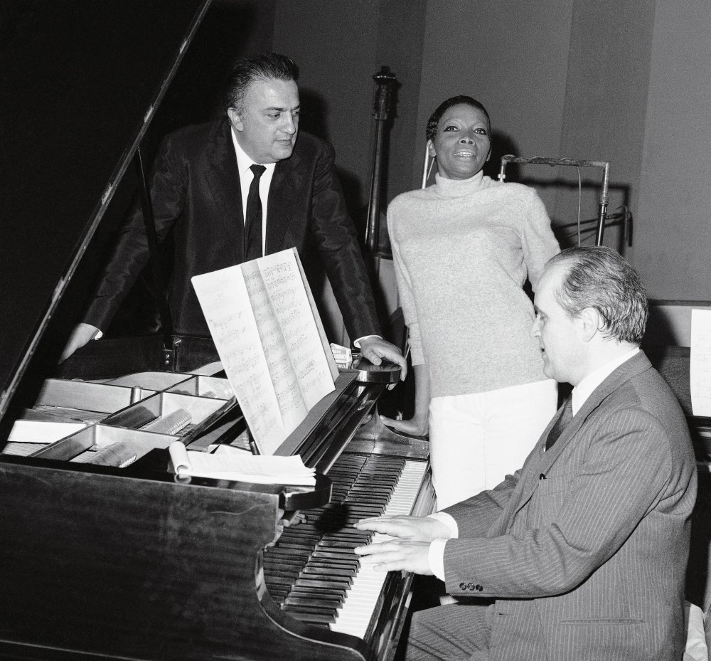 Director Federico Fellini, Cuban singer Wanani (Valeria Ferran) and composter Nino Rota recording the theme song for Juliet of the Spirits in 1965