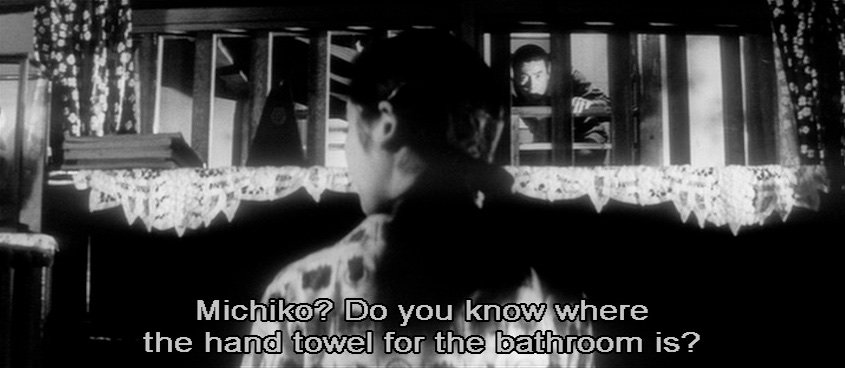 Nanbu's aggressive instincts are tempered only by his surreptitious encounters with Michiko, his landlord's daughter. This single-take scene provides a wonderful example of Suzuki's efficient use of depth within a scene. Nanbu's cloying obsession with Michiko is emphasised by the dappled shadows created on the righthand back wall by leaves blown by a gale outside. The wind adds an undercurrent of dramatic tension on the soundtrack too. As Michiko melodically practices at the piano, her mother's voice off screen asks where the towels are, before the camera pans left to reveal Nanbu's guilty departure through the back door