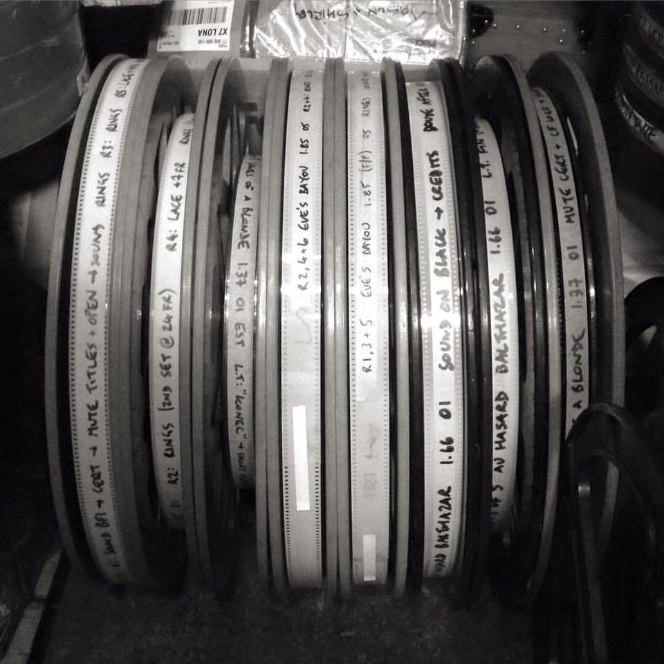 Celluloid film cans ready for projection at the Overnight Film Festival