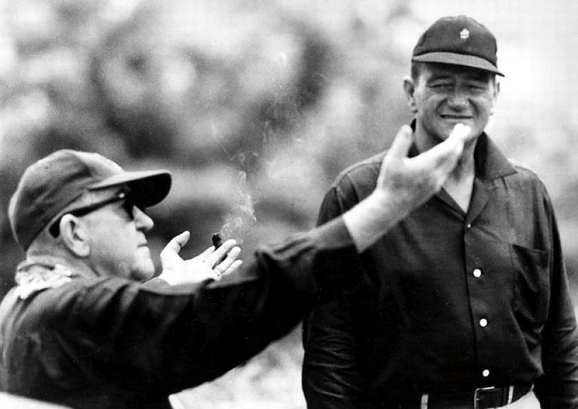 John Ford (left) directing John Wayne on the set of Flashing Spikes (1962)