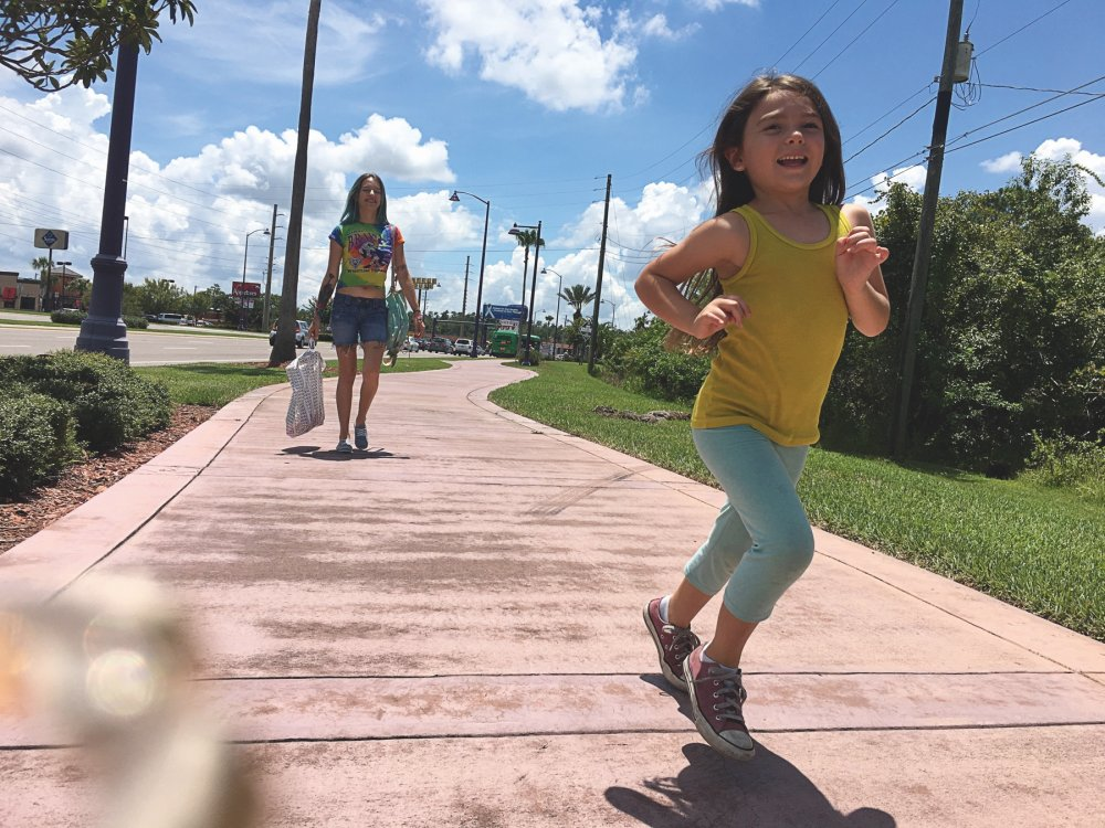 Bria Vinaite as Halley and Brooklynn Prince as Moonee in Sean Baker's The Florida Project