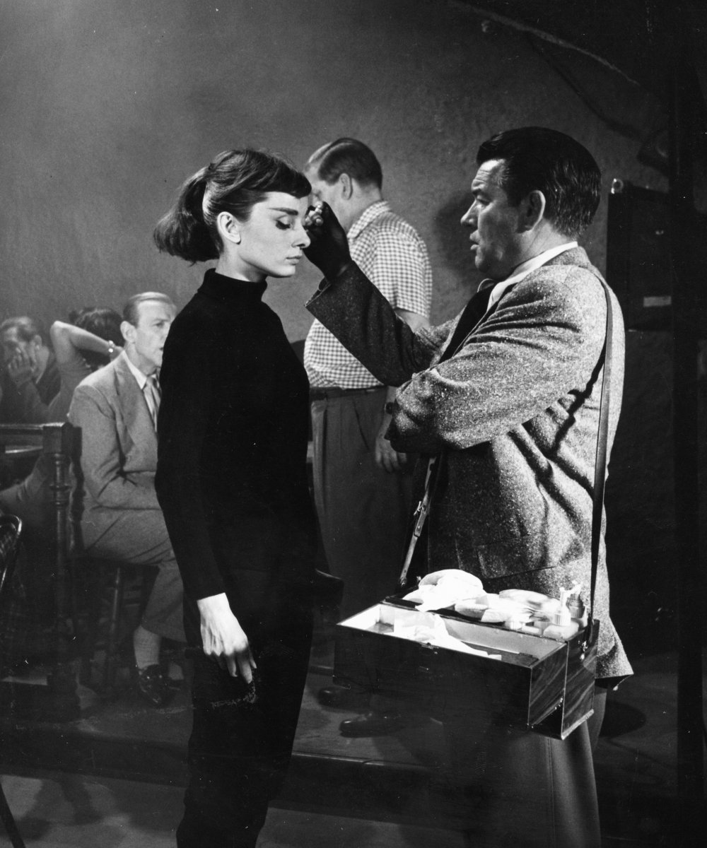 Hepburn's personal makeup artist Wally Westmore applies her mascara. He was known to separate each of her eyelashes with a sewing pin so that the results would look more defined on camera. Westmore also worked with Hepburn on Roman Holiday (1953) and Breakfast at Tiffany's (1961)