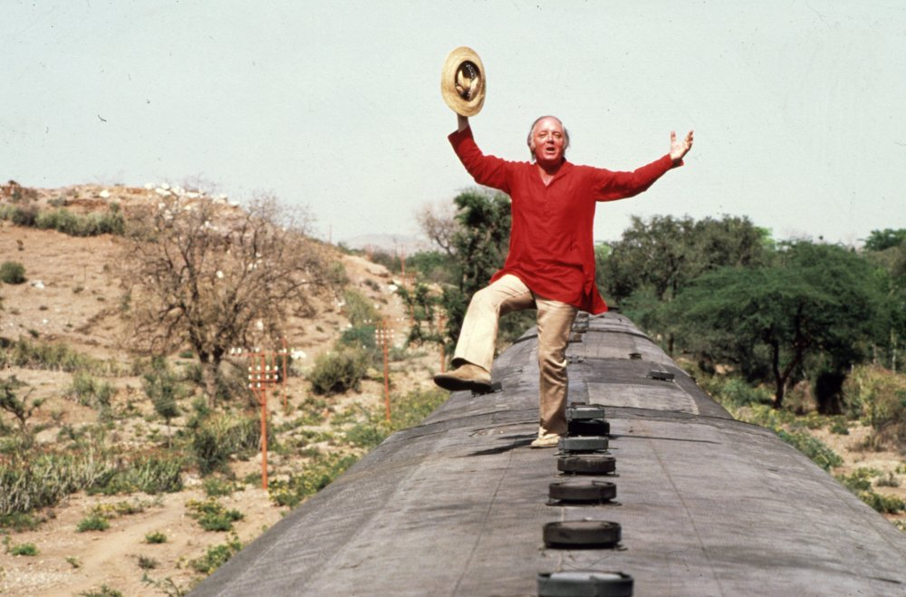 Richard Attenborough dancing atop a steam train on location for Gandhi (1982)