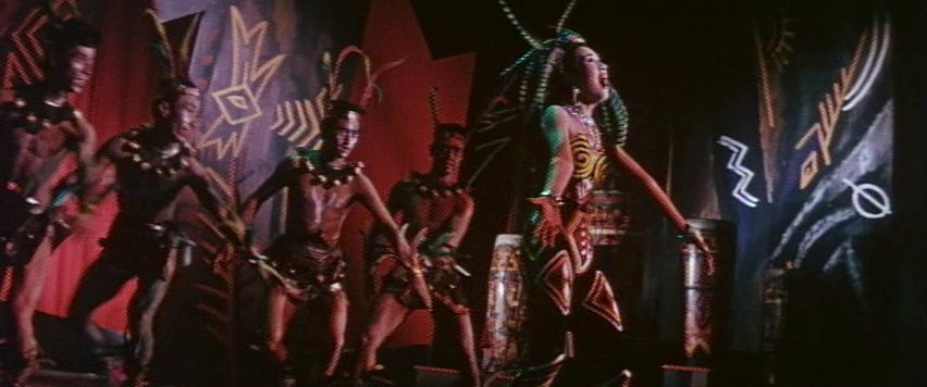 The exoticism and spectacle of musicals made them well-suited to the new widescreen era. Here Masumura includes an exotic cabaret show that serves as spectacle in its own right, while depicting Kyoko's liberation from the shackles of her role as World Caramel poster girl