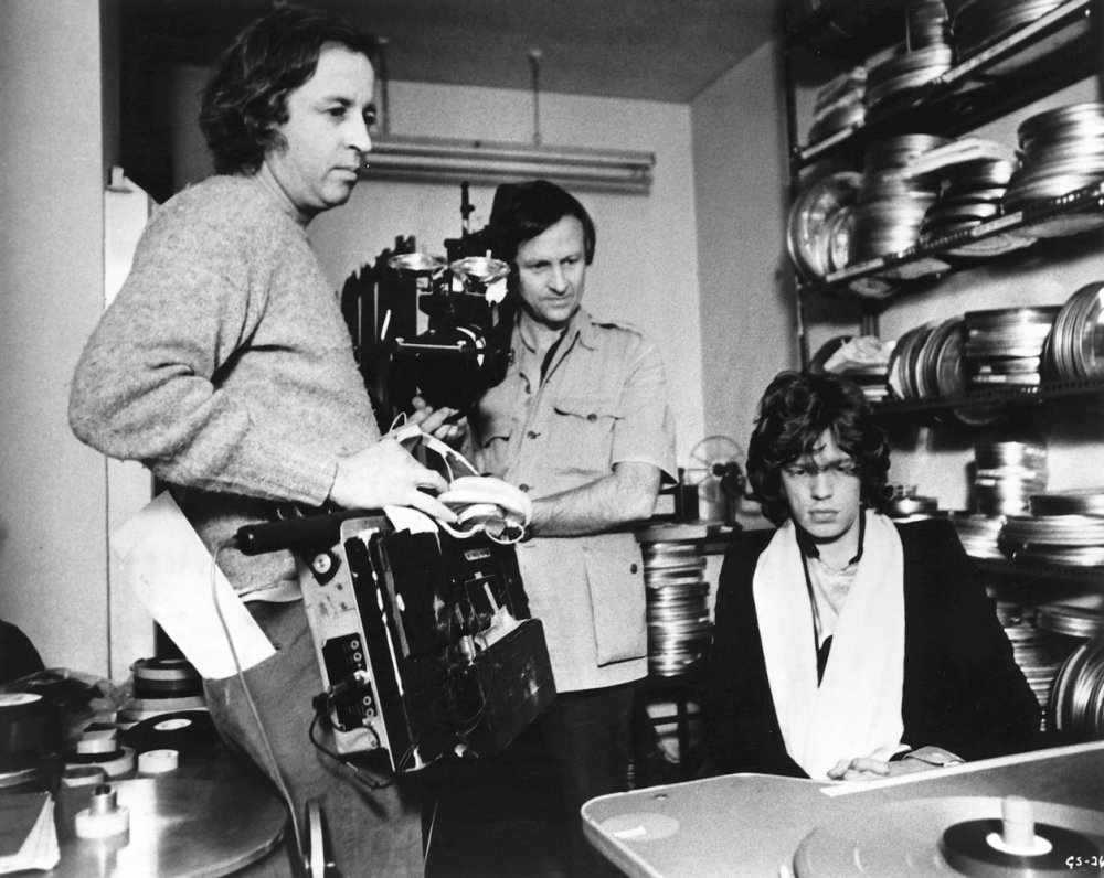 Albert (centre) and David Maysles with Mick Jagger looking at footage in Gimme Shelter (1970)