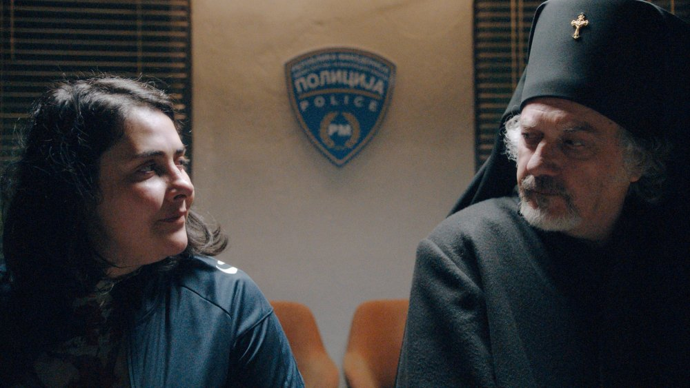 Zorica Musheva as Petrunija with Suad Begovski as The Priest in God Exists, Her Name is Petrunya