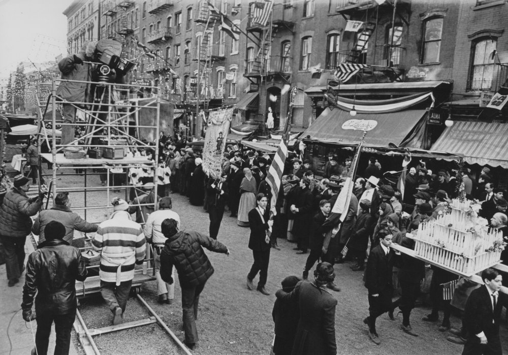 Shooting the religious parade during the Feast of San Gennaro in Little Italy. In The Godfather Part II, the procession is the backdrop for the young Vito Corleone's (Robert De Niro) assassination of local kingpin Don Fanucci (Gastone Moschin)