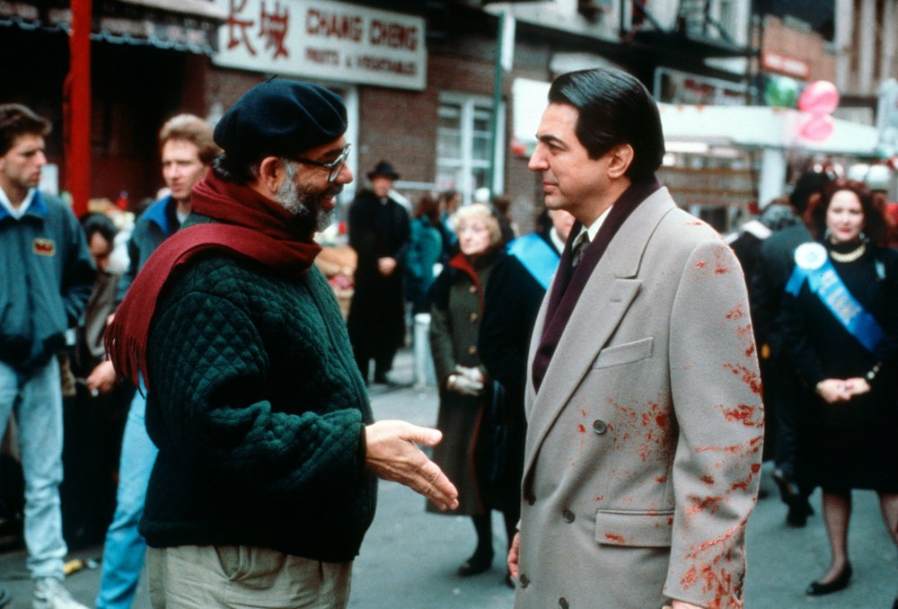 Joe Mantegna (left) as the fated Joey Zasa, sharing a convivial moment with his director between shots