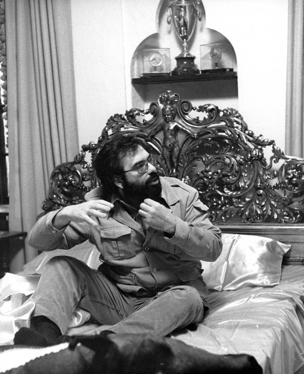 Coppola on the ornate bed used in the famous scene in which movie producer Jack Woltz awakes to find a bloody horse's head lying next to him