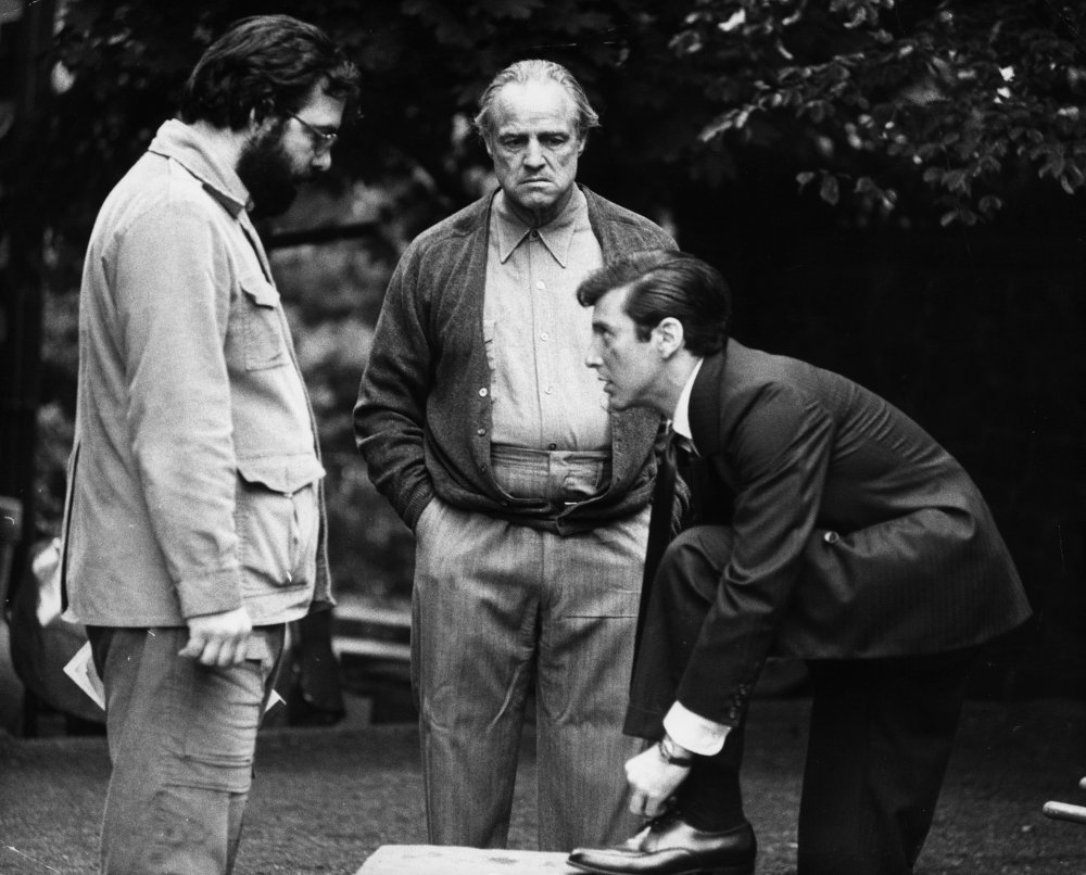Coppola and Brando with Al Pacino as Michael Corleone, who finds himself drawn inexorably into his father's murky life of organised crime