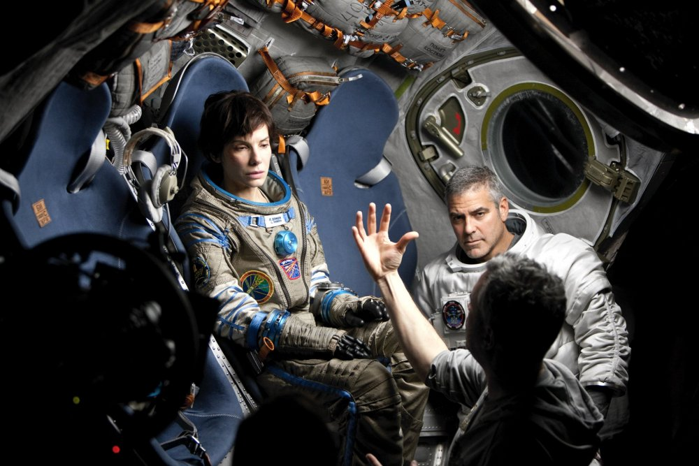 Alfonso Cuarón directing George Clooney and Sandra Bullock on the set of Gravity (2013)