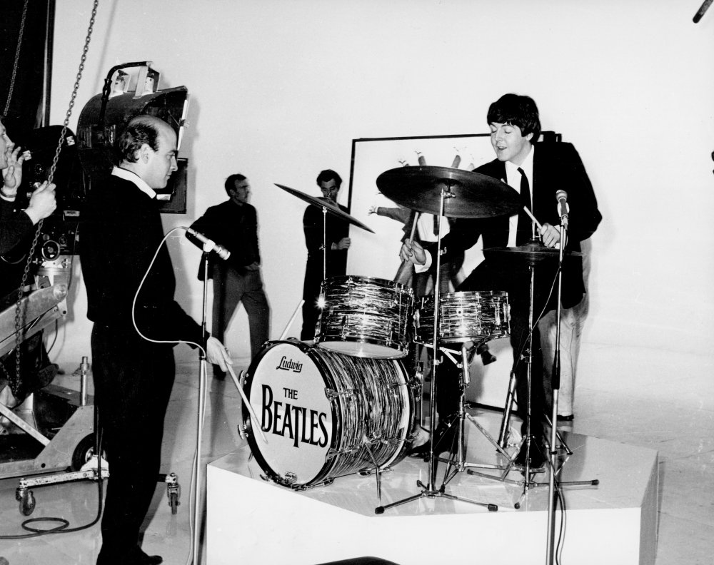 Richard Lester and Paul McCartney on the set of A Hard Day's Night. Director and star play on Ringo's drums. Lester is himself a talented musician