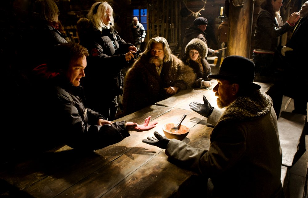 Quentin Tarantino directing Tim Roth and company on the set of The Hateful Eight (2015)