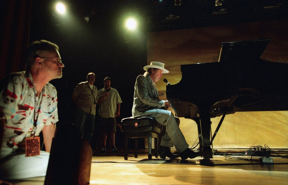 Demme watching Neil Young perform for their concert documentary Neil Young: Heart of Gold (2006)