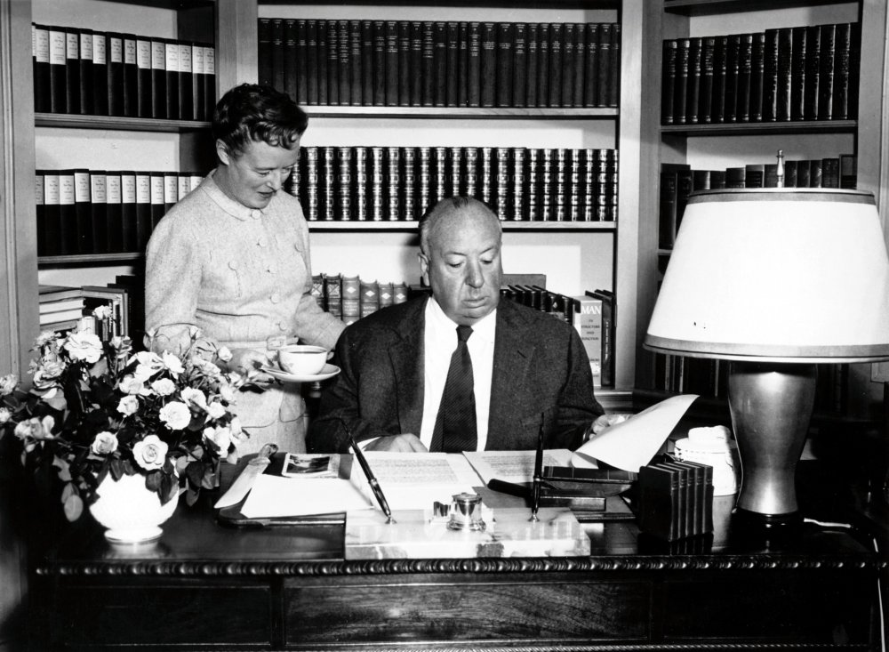 Alfred Hitchcock at study (with his wife Alma Reville)