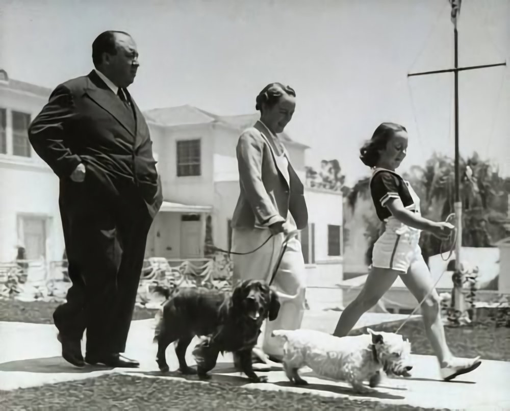 The family Hitchcock near their first Los Angeles home on Wilshire Boulevard, as depicted in a 1939 Life magazine profile