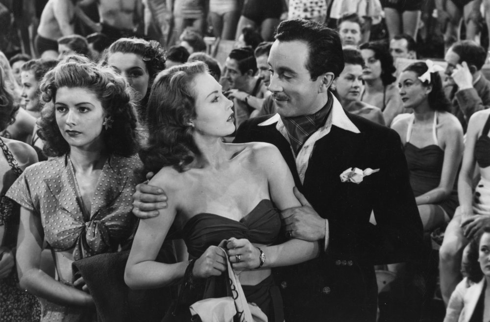 Hazel Court and Dennis Price in Holiday Camp (1947). This was Annakin's feature debut. Set in a Butlin's resort on the Yorkshire coast, and showing sympathetic working-class characters, it was a huge success and spawned the Huggett series based on the central characters Joe and Ethel ('Pa' and 'Ma') Huggett, played by Jack Warner and Kathleen Harrison