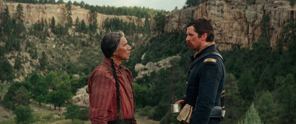 Wes Studi as Chief Yellow Hawk and Christian Bale as Captain Joseph J. Blocker in Scott Cooper's Hostiles