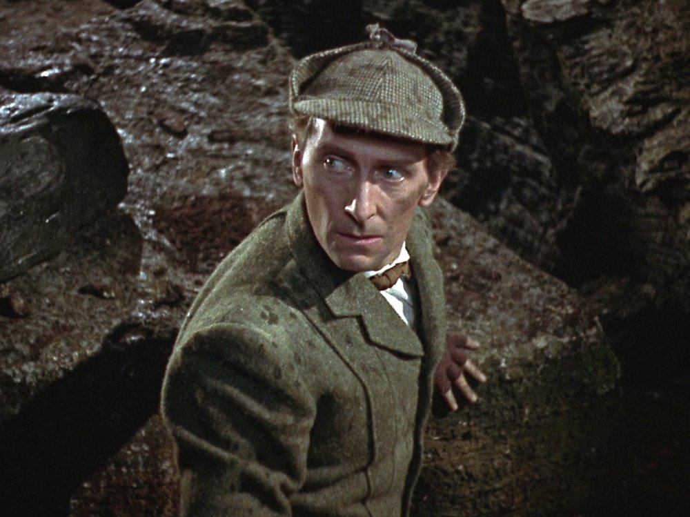 Peter Cushing, the most prolific British male actor of the 1970s, playing Sherlock Holmes, the third most featured character, in The Hound of the Baskervilles (1959)