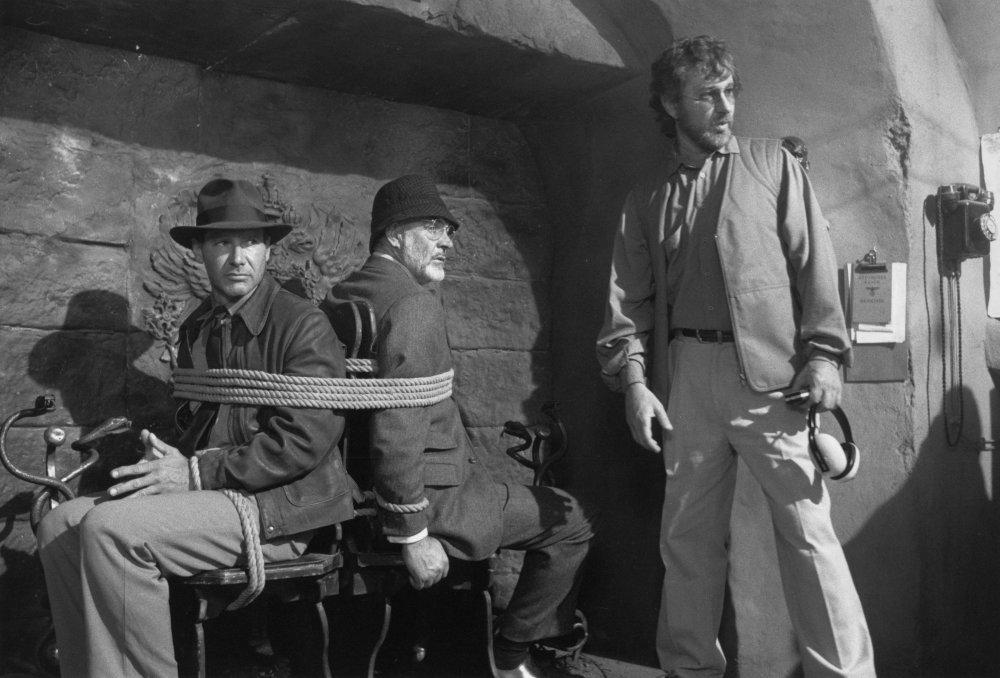 Harrison Ford and Sean Connery are bound together in a mechanical, revolving fireplace in the German castle sequence of Indiana Jones and the Last Crusade