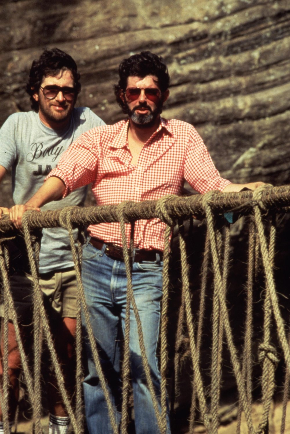 Spielberg and writer-producer George Lucas tread the treacherous rope bridge used in the finale of Indiana Jones and the Temple. The rope bridge set was constructed at Elstree Studios in Hertfordshire