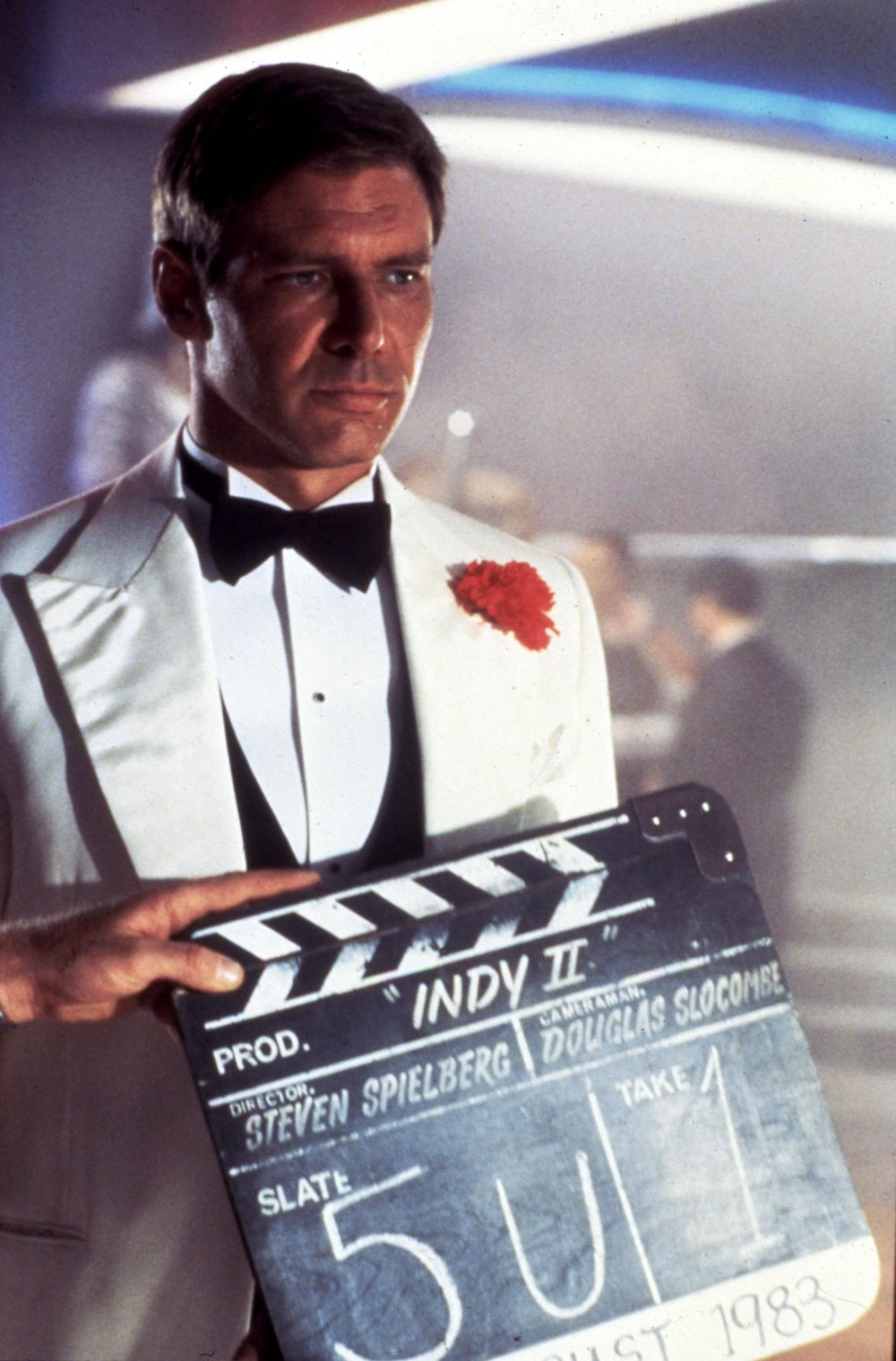 A dinner-jacketed Harrison Ford readies to film the Shanghai nightclub scene that begins 'Indy II'