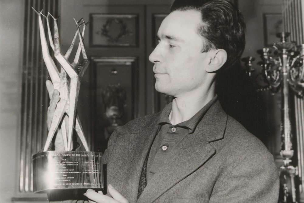 French New Wave director Jacques Rivette with his Sutherland Award for Paris nous appartient at the 1962 London Film Festival