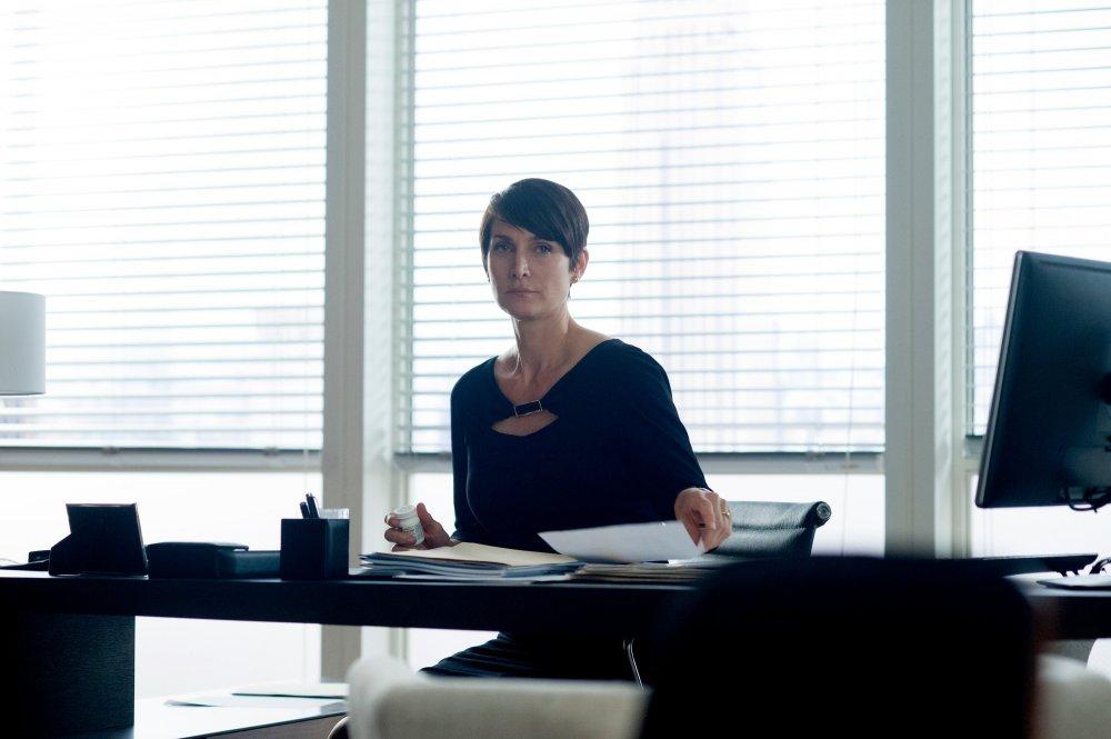 Carrie-Anne Moss as cutthroat lawyer Jeri Hogarth